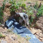 The Water Project: Mwichina Community, Matanyi Spring -  Adding Tarp Over Stones