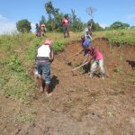 The Water Project: Kalenda A Community, Webo Simali Spring -  Backfilling With Soil