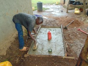 The Water Project:  Cementing Slab