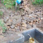 The Water Project: Maondo Community, Ambundo Spring -  Backfilling