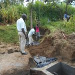 The Water Project: Kalenda B Community, Lumbasi Spring -  Backfilling With Soil