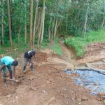 The Water Project: Kitulu Community, Kiduve Spring -  Soil Backfilling