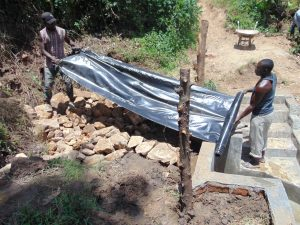 The Water Project:  Laying Of Tarp