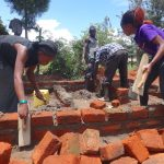 The Water Project: Chiliva Primary School -  Field Officers Help Lay Bricks
