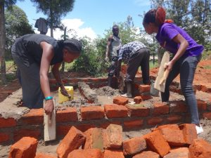 The Water Project:  Field Officers Help Lay Bricks