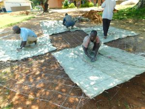 The Water Project:  Tying Sugar Sacks To Dome Wire