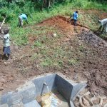The Water Project: Maondo Community, Ambundo Spring -  Soil Backfilling Over Tarp