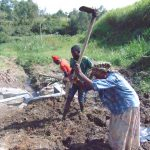 The Water Project: Emurumba Community, Makokha Spring -  Backfilling With Soil