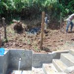 The Water Project: Mukangu Community, Metah Spring -  Backfilling With Soil And Fencing