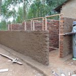 The Water Project: Saride Primary School -  Cementing And Framing The Latrines