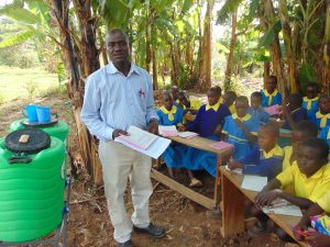 The Water Project:  Senior Teacher Kebaso Mosioma Addresses Pupils At Training