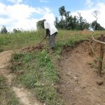 The Water Project: Kalenda A Community, Webo Simali Spring -  Digging Cut Off Drainage