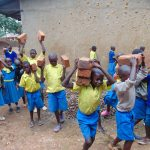 The Water Project: Saride Primary School -  Pupils Bring Bricks For Construction