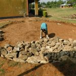 The Water Project: Sawawa Secondary School -  Adding Stones For Foundation