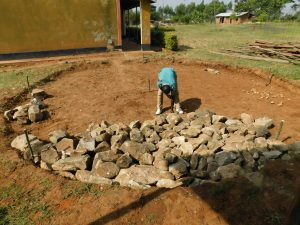 The Water Project:  Adding Stones For Foundation