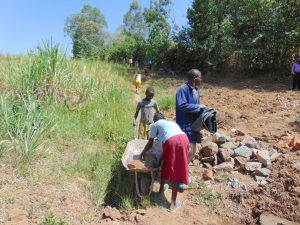 The Water Project:  Communtiy Members Deliver Materials