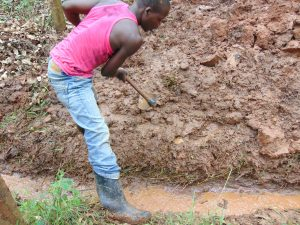 The Water Project:  Clearing The Drainage Channel
