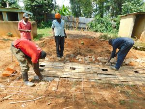 The Water Project:  Building Latrine Foundation