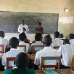 The Water Project: Sawawa Secondary School -  Sanitation Teacher Addresses Students