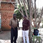 The Water Project: Mwichina Community, Matanyi Spring -  Field Officer Samuel Having A Light Moment With Mr Matanyi