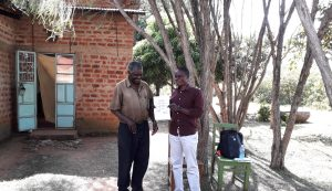 The Water Project:  Field Officer Samuel Having A Light Moment With Mr Matanyi