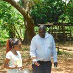 The Water Project: Namarambi Community, Iddi Spring -  Trainer Prepares Toothbrushing Volunteer