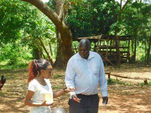 The Water Project:  Trainer Prepares Toothbrushing Volunteer