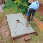 The Water Project: Kitulu Community, Kiduve Spring -  Finishing A Sanitation Slab