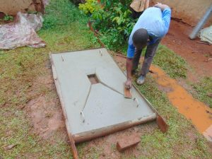 The Water Project:  Finishing A Sanitation Slab