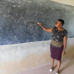 The Water Project: Sawawa Secondary School -  Facilitator Using Chalk Board Illustrations