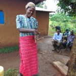 The Water Project: Musiachi Community, Mutuli Spring -  Woman Demonstrates Handwashing