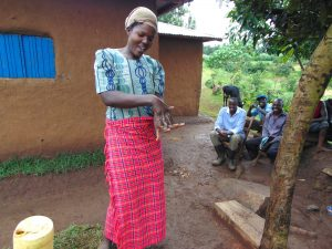 The Water Project:  Woman Demonstrates Handwashing