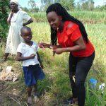 The Water Project: Bukhaywa Community, Shidero Spring -  Trainer Georgina Teaches Toothbrushing
