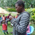 The Water Project: Mukangu Community, Metah Spring -  Participant Reads Toothpaste Ingredients
