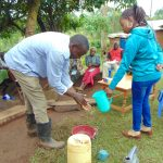 The Water Project: Musiachi Community, Mutuli Spring -  Man Demonstrates Handwashing