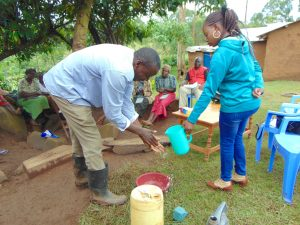 The Water Project:  Man Demonstrates Handwashing
