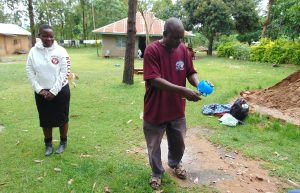 The Water Project:  Mr Lusimba Demonstrates Toothbrushing