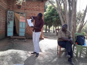 The Water Project:  Mr Matanyi Seated Up Front