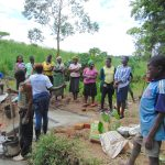 The Water Project: Maondo Community, Ambundo Spring -  Trainer Jemmimah Leads Site Management Training