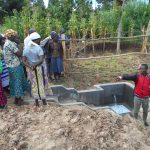 The Water Project: Kalenda B Community, Lumbasi Spring -  Ian Points Out A Spring Feature