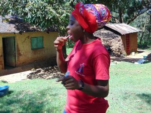 The Water Project:  Georgina Demonstrates Toothbrushing