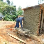 The Water Project: Hobunaka Primary School -  Cementing Latrines