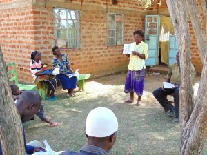 The Water Project:  A Woman Leads A Discussion