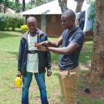 The Water Project: Imusutsu Community, Ikosangwa Spring -  Samuel Demonstrates Handwashing