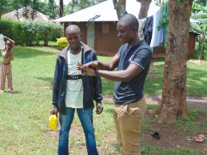 The Water Project:  Samuel Demonstrates Handwashing
