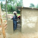 The Water Project: Hobunaka Primary School -  Latrine Plaster Work