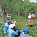 The Water Project: Kitulu Community, Kiduve Spring -  Participants Lead Discussions Using Posters
