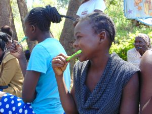 The Water Project:  Participants Imitate Toothbrushing