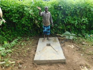 The Water Project:  Standing Proud With New Sanitation Slab