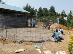 The Water Project:  Fitting Rebar To Foundation